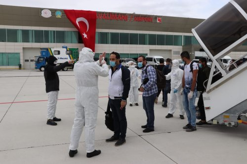 Turkish citizens arrive at Kutahya Zafer Airport after a plane of Turkey's national carrier Turkish Airlines, evacuated the citizens stranded in Sudan due to the measures taken to curb the spread of the novel coronavirus known as COVID-19, in Kutahya, Turkey on 22 April 2020. [Muharrem Cin - Anadolu Agency]