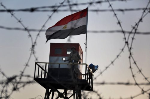 An Egyptian security guard is seen between Egypt and the Gaza Strip on 1 July 2013 [Mohammed Talatene/ApaImages]