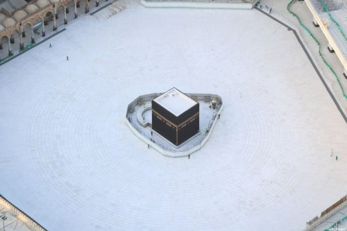 An aerial view shows an empty white-tiled area surrounding the Kaaba in Mecca's Grand Mosque, on 6 March, 2020 [BANDAR ALDANDANI/AFP via Getty Images]