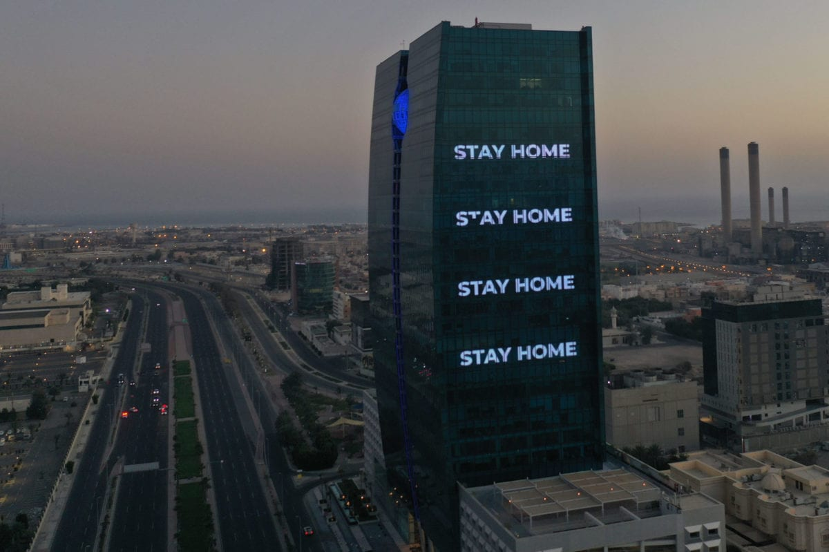 "An aerial view shows deserted streets in the Saudi coastal city of Jeddah on 21 April 2020, as the message ""stay home"" is displayed on a tower during the novel coronavirus pandemic crisis. [BANDAR ALDANDANI/AFP via Getty Images]"
