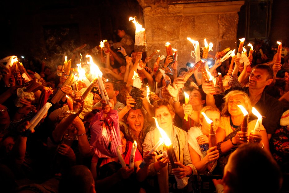 Christian worshipers light candles lit from a flame that emerged from the tomb believed to be of Jesus Christ as they take part in the ceremony of the holy fire at the Church of the Holy Sepulcher 4 May, 2013 in Jerusalem, Israel. [Lior Mizrahi /Getty Images]