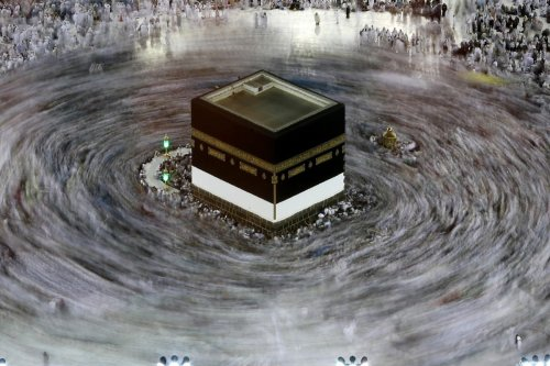 This long exposure photograph shows Muslim pilgrims circumambulating the Kaaba, Islam's holiest shrine, at the Grand Mosque in Saudi Arabia's holy city of Mecca on 27 August, 2017 [KARIM SAHIB/AFP via Getty Images]