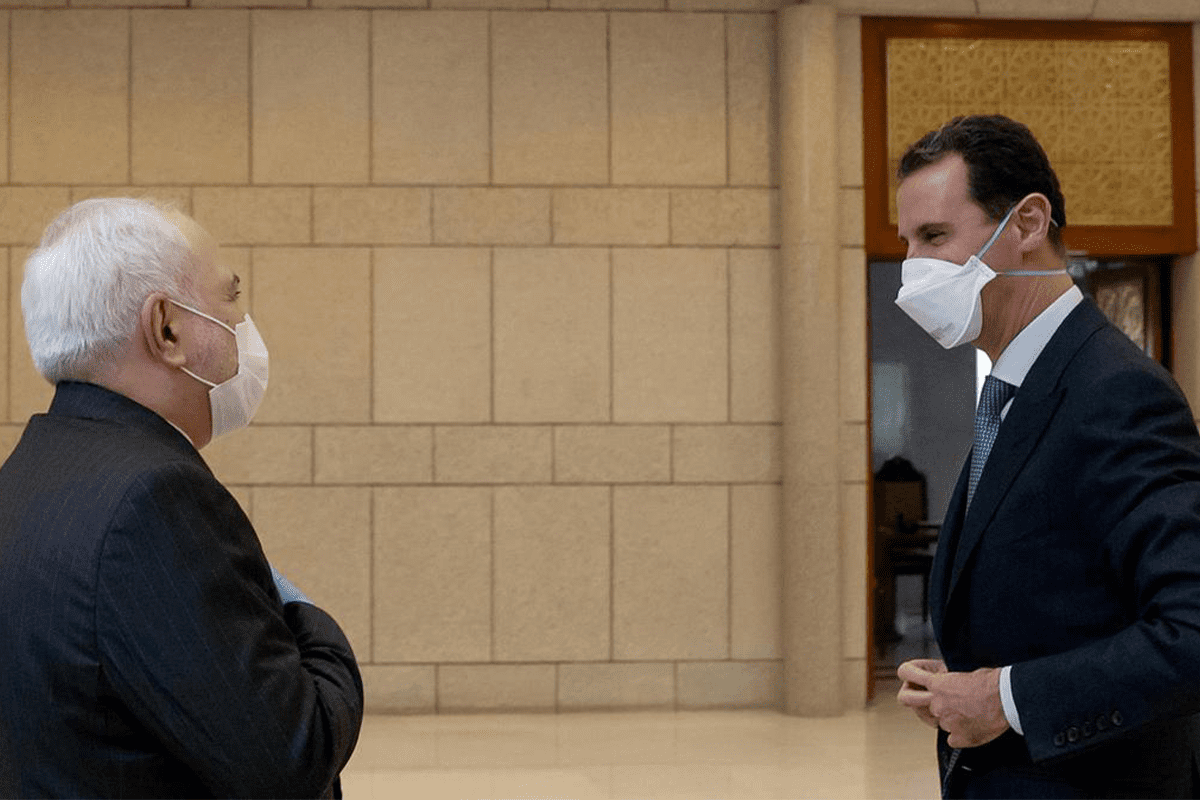 Syrian President Bashar al-Assad and Iranian Foreign Minister Mohammad Javid Zarif wore face masks for their meeting in Damascus on 20 April, 2020 [Twitter]