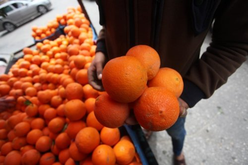 Oranges are seen at a fruit stall on 1 April 2020 [Mahmoud Ajjour/ApaImages]