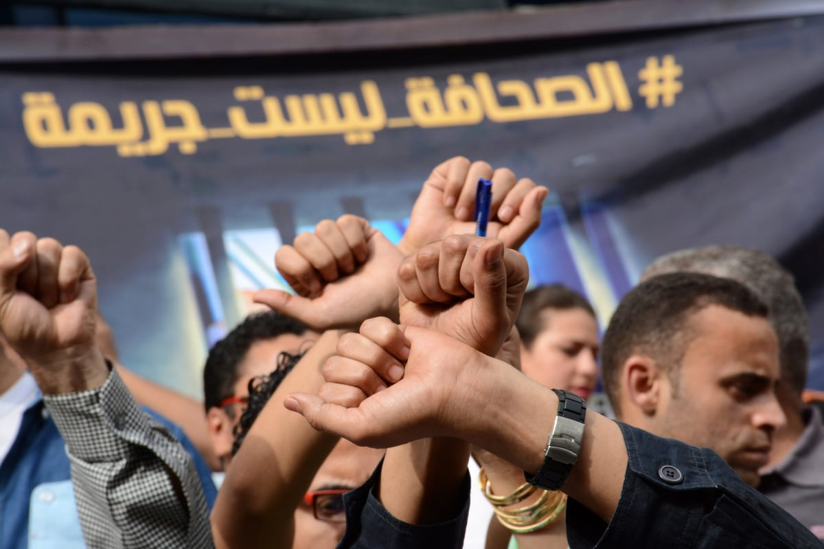 Egyptian Journalists take part during a protest against the arrests of fellow journalists outside the Egyptian Journalist syndicate headquarters in the capital Cairo on 3 May 2016 on the occasion of World Press Freedom day. [Amr Sayed/Apaimages]