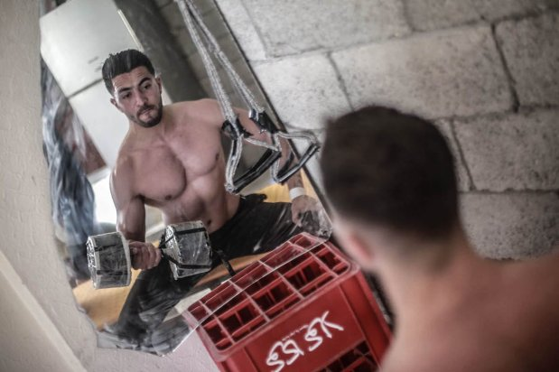 Bodybuilder Ahmed El-Thalathiny, 27, says he cannot allow coronavirus measures to force him to reverse progress he has made in his fitness levels, on 4 May 2020, in Gaza [Mohammed Asad/Middle East Monitor]