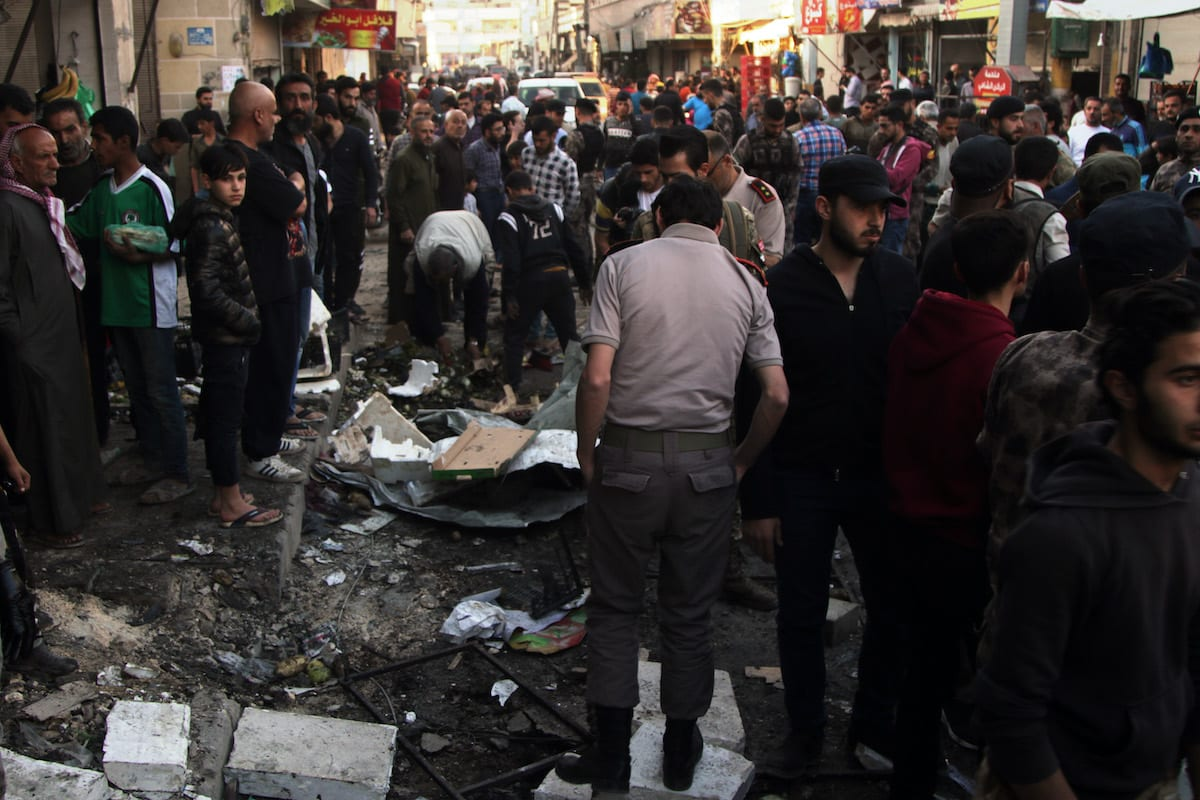 ALEPPO, SYRIA - MAY 10: Officials inspect the scene after a bomb attack carried out by PKK, listed as a terrorist organization by Turkey, the U.S. and the EU, and Syrian Kurdish YPG militia, which Turkey regards as a terror group, in the city center of al-Bab in northern Syria on May 10, 2020. According to initial reports, at least 11 civilian wounded with one seriously says Turkish Ministry of Defense. ( Mustafa Bathis - Anadolu Agency )