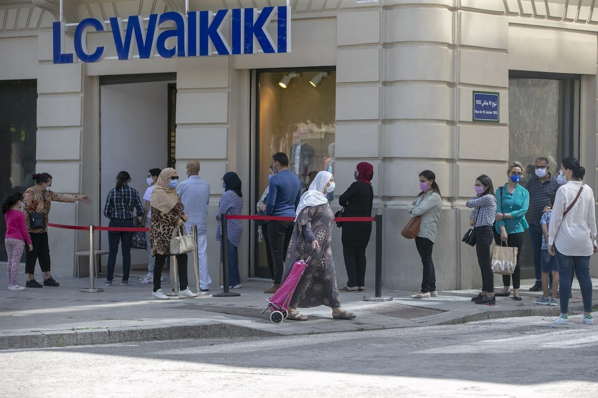 TUNIS, TUNISIA - MAY 11: People wearing masks line up in front of stores after measures against the novel coronavirus (COVID-19) began to be lifted 2 months later in Tunis, Tunisia on May 11, 2020. ( Yassine Gaidi - Anadolu Agency )