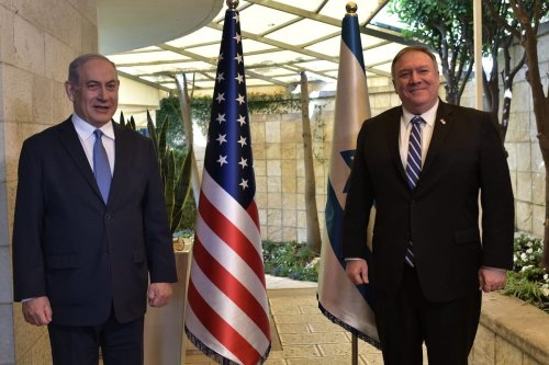 US Secretary of State Mike Pompeo (R) meets with Israeli Prime Minister Benjamin Netanyahu (L) after traveling abroad for the first time amid the novel coronavirus (COVID-19) pandemic in West Jerusalem on 13 May 2020. [Kobi Gideon / GPO / Handout - Anadolu Agency]