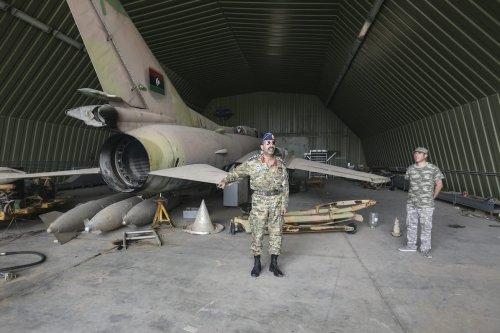The GNA military spokesman Mohammed Kanunu inspects airbase after Libya's army retook Al-Watiya airbase occupied by warlord Khalifa Haftar's militias within 'Volcano of Rage' Operation in Tripoli, Libya on 18 May 2020. [Hazem Turkia - Anadolu Agency]