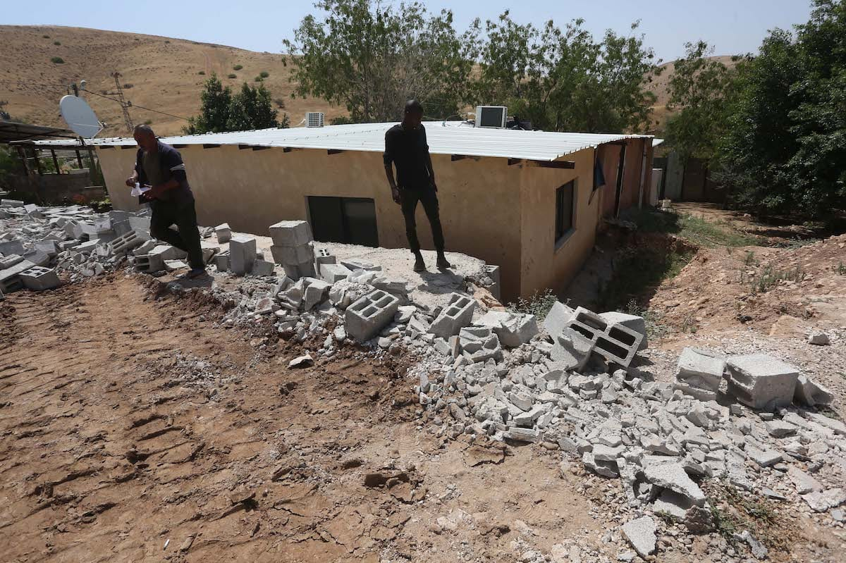 Palestinians inspect the rubble of a house after demolished due to allegedly unlicensed construction by Israeli forces in Furush Beit Dajan village in Nablus, West Bank on May 27, 2020. [Nedal Eshtayah - Anadolu Agency]