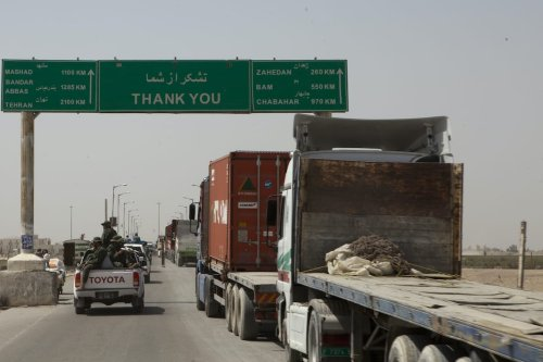 Trucks wait to cross the Afghanistan-Iran border in Zaranj, Afghanistan, May 10, 2011. [U.S. Marine Corps/Wikipedia]