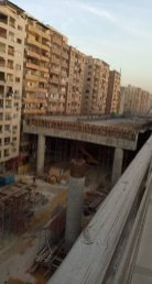 Egypt has been building a bridge adjacent to – and almost touching - residential buildings in Giza, causing an outcry from local residents and social media users
