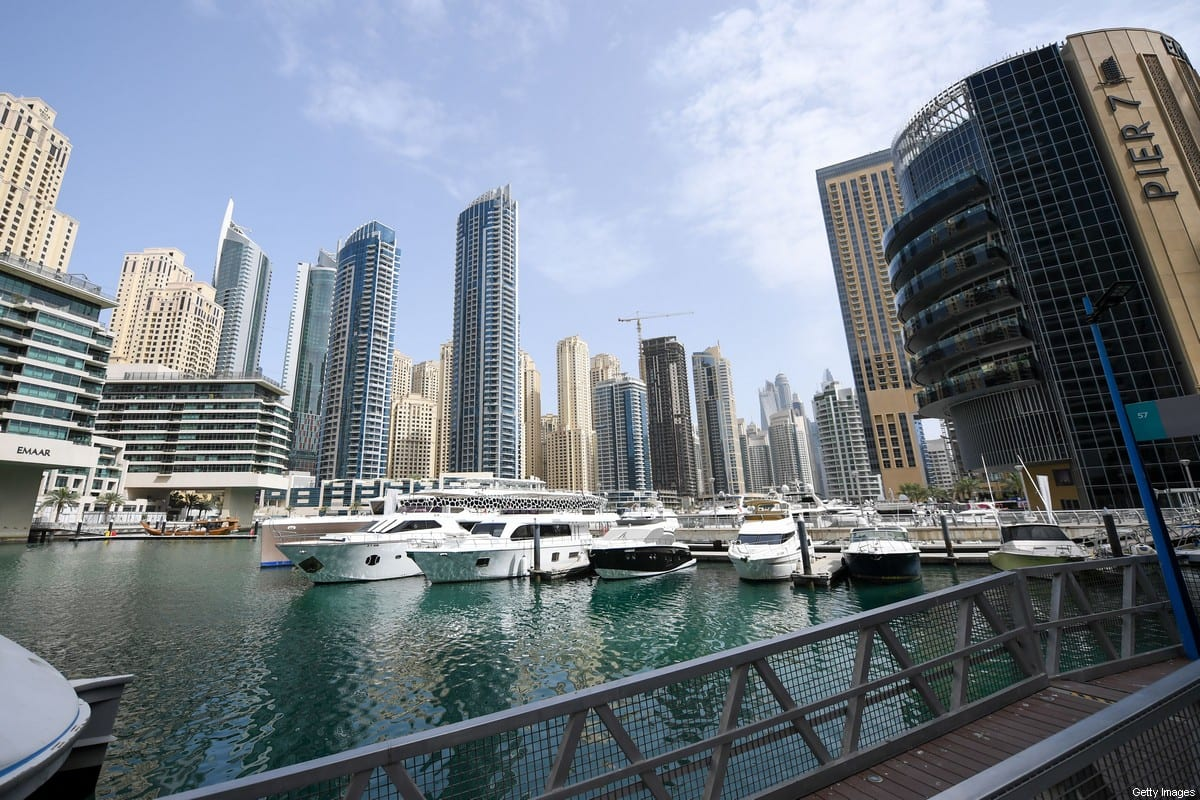 Under coronavirus lockdown, boats are seen docked in Dubai's empty marina on March 16, 2020 [KARIM SAHIB/AFP via Getty Images]