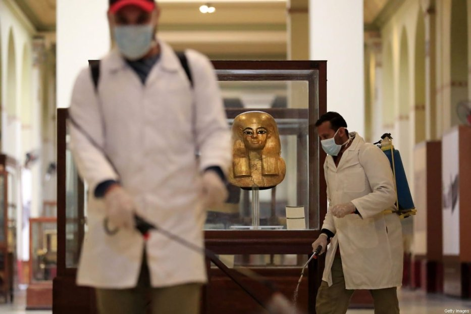 Workers disinfect a gallery at the Egyptian Museum in Cairo's landmark Tahrir Square amid the coronavirus COVID-19 pandemic, on March 23, 2020. (Photo by Khaled DESOUKI / AFP) (Photo by KHALED DESOUKI/AFP via Getty Images)