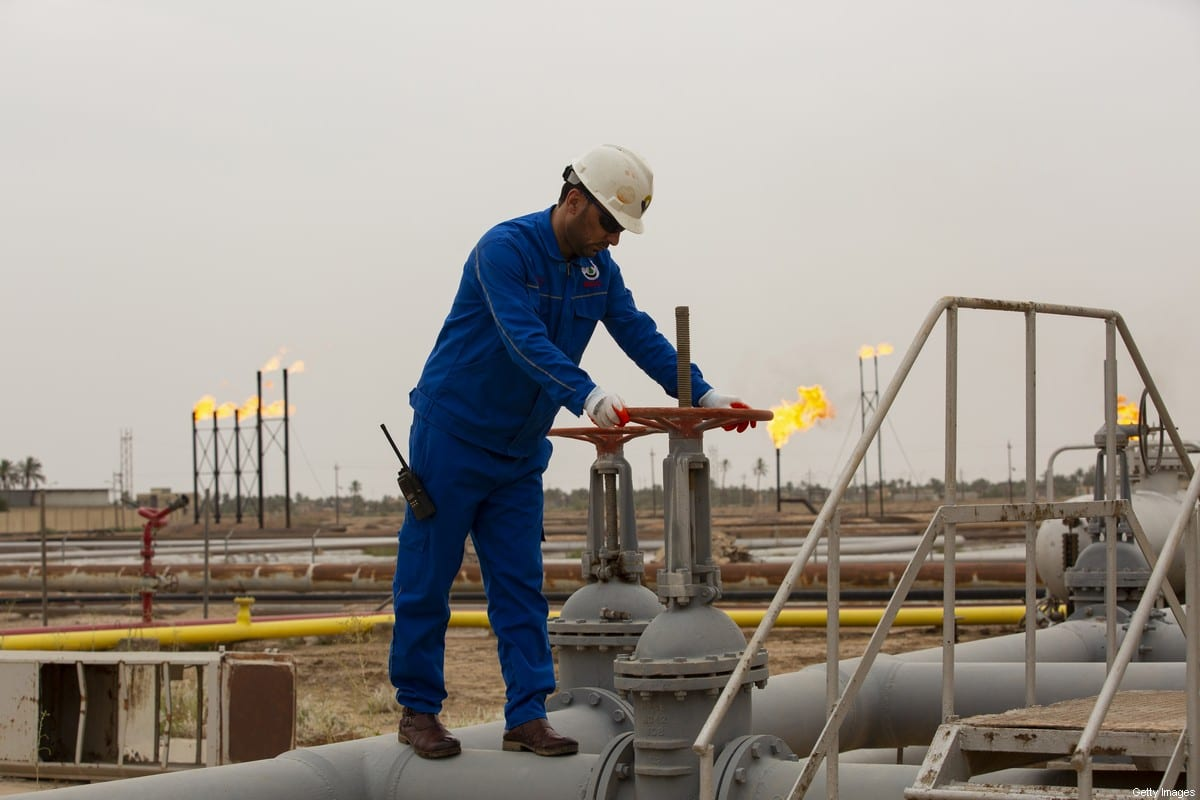 An employee turns a valve at the Nahr Bin Omar natural gas field, north of the southern Iraqi port of Basra on April 21, 2020. (Photo by Hussein FALEH / AFP) (Photo by HUSSEIN FALEH/AFP via Getty Images)