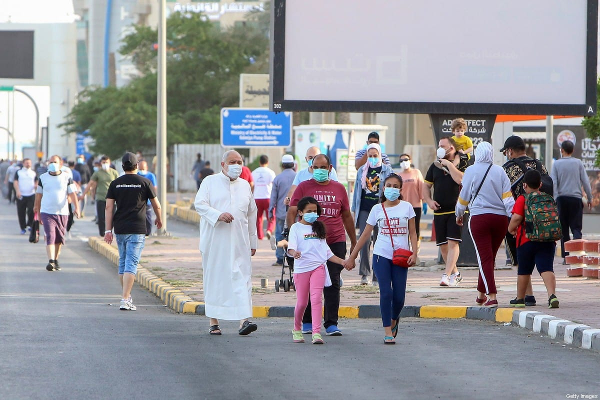 Mask-clad residents walk in a neighbourhood of Kuwait City on May 12, 2020, as authorities allowed people to exercise for two hours under a nationwide lockdown due to the COVID-19 pandemic [YASSER AL-ZAYYAT/AFP via Getty Images]