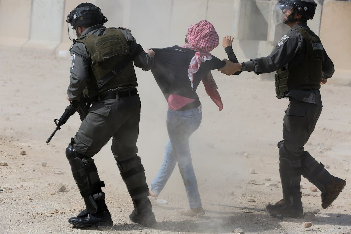 Israeli border guards detain a Palestinian protester during clashes following a demonstration by students from Birzeit University near Ramallah against the incarceration in Israeli jails of Palestinian university students, on 10 March, 2015 [ABBAS MOMANI/AFP via Getty Images]