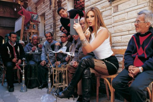 An undated file picture shows Lebanese singer Suzanne Tamim posing during a photoshoot in Egypt. Tamim was found dead in the Gulf emirate of Dubai on July 28, 2008, a security official told AFP. No further details about the cause of death were released. STR/AFP via Getty Images]