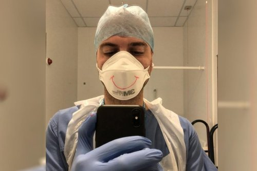 Award winning film maker Hassan Akkad poses in PPE gear after he began work as a cleaner in East London at Whipps Cross hospital [Hassan Akkad/Instagram]