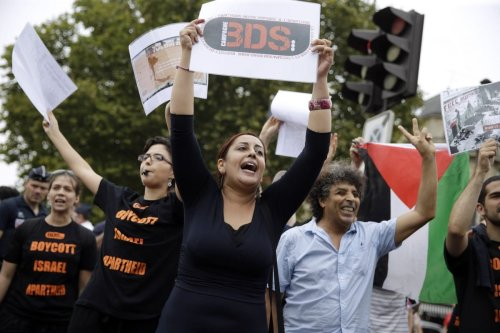 Demonstrators supporting the Boycott, Divestment and Sanctions (BDS) movement in Paris, France on 13 August 2015 [KENZO TRIBOUILLARD/AFP/Getty Images]
