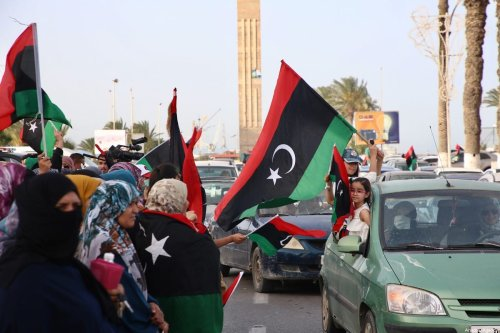 People gather at Martyrs' Square to celebrate after the internationally-recognised Libyan government seized control of the Tripoli's provincial administrative boundaries from the forces of renegade General Haftar's forces, on July 4, 2020 in Tripoli, Libya [Hazem Turkia / Anadolu Agency]