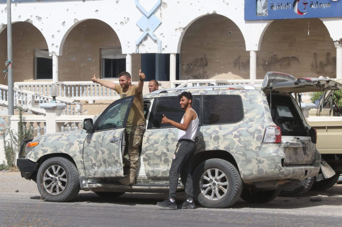 Libyan Army members celebrate as they head towards Tarhuna, after retaking the country's main airport from warlord Khalifa Haftar's militias, announcing the complete liberation of the capital Tripoli, on 4 June 2020 in Tripoli, Libya. [Hazem Turkia - Anadolu Agency]