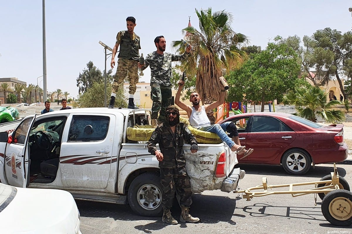 Members of The Libyan Army celebrate after they liberated the strategic Tarhuna city, the last stronghold of warlord Khalifa Haftar in western Libya on June 05, 2020 [Hazem Turkia/Anadolu Agency]