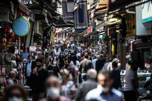People walk at Egyptian market during the first weekend without curfew imposed since 10th April, for several weeks to stem spread of coronavirus (Covid-19) pandemic in Istanbul, Turkey on June 6, 2020 [Onur Çoban / Anadolu Agency]