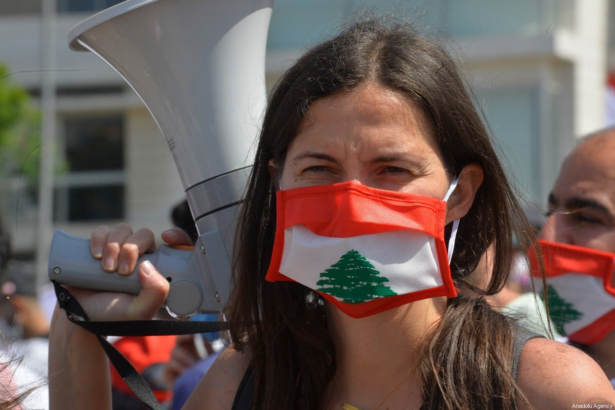 Lebanese protester poses for a photo as thousands of people gather at Martyrs' Square during a demonstration to protest against economic crisis and high cost of living, on June 06, 2020 in Beirut, Lebanon [Hussam Chbaro / Anadolu Agency]