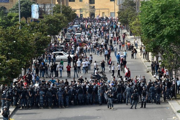 Lebanese security forces take security measures as thousands of people gather at Martyrs' Square during a demonstration to protest against economic crisis and high cost of living, on June 06, 2020 in Beirut, Lebanon [Hussam Chbaro / Anadolu Agency]