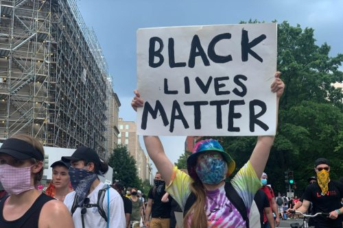 Demonstrators march down Black Lives Matter Plaza during a protest against police brutality and racism on June 6, 2020 in Washington, DC [Yasin Öztürk/Anadolu Agency]