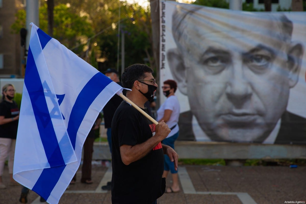 Israelis gather to stage a demonstration to protest against Israel's annexation plan for the illegal settlements in West Bank and Jordan Valley, in Tel Aviv, Israel on June 6, 2020 [Nir Keidar / Anadolu Agency]