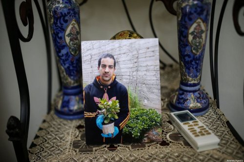 A photo of Autistic Palestinian man Eyad Hallaq (32) who was killed by Israeli police in East Jerusalem, at the Old City's Lions' Gate on May 30 2020 [Mostafa Alkharouf / Anadolu Agency]