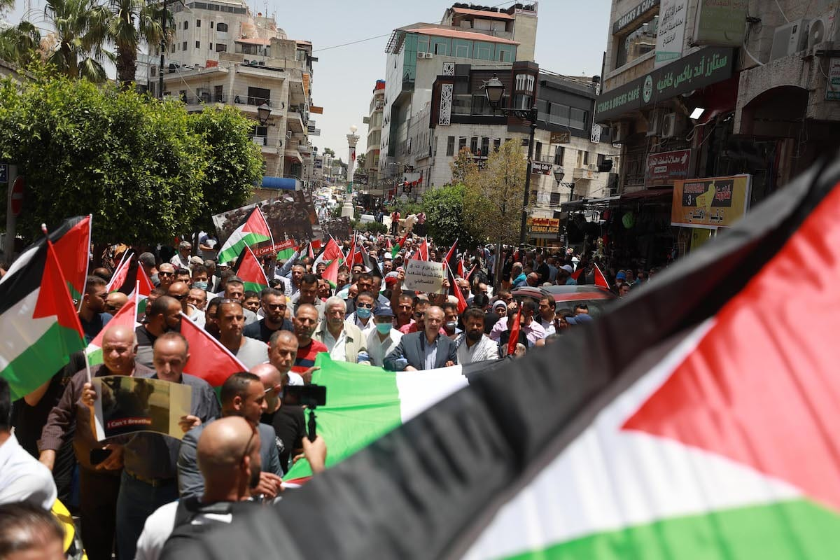 Palestinians gather to stage a protest annexation plans in the West Bank on 8 June 2020 [Issam Rimawi/Anadolu Agency]