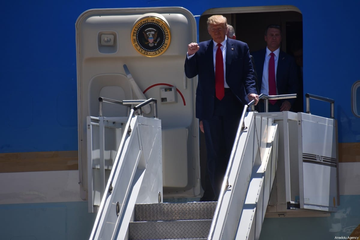 US President Donald Trump pumps his fist as he steps off Air Force One upon arrival in Dallas, Texas, on June 11, 2020, where he will host a roundtable with faith leaders and small business owners [Kyle Mazza / Anadolu Agency]