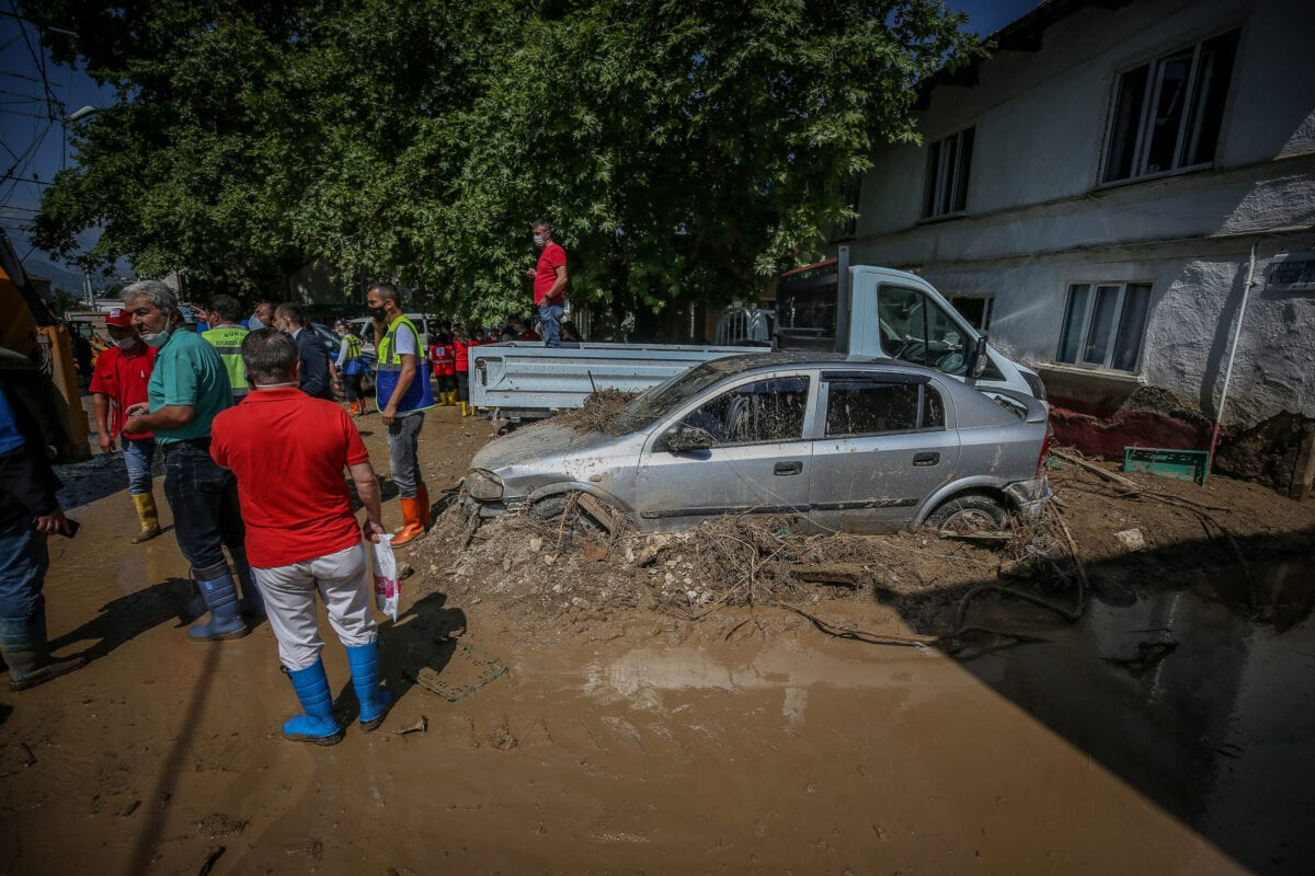 Damaged buildings and vehicles are seen while the damage assessment and cleaning operations continue at Dudakli neighbourhood in Kestel district of Bursa, Turkey on June 22, 2020. At this neighbourhood with 130 residences, where approximately 550 people live, many houses were damaged by flood, nearly 50 tractors and cars were flooded [Sergen Sezgin - Anadolu Agency]