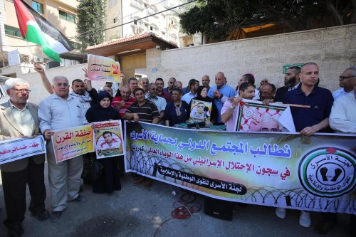 Palestinians protest in support of detainee rights in Gaza, Palestine, on 14 June 2020 [Mohammed Asad/Middle East Monitor]