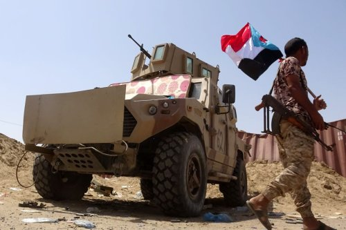 A fighter loyal to Yemen's separatist Southern Transitional Council (STC) holds the separatist flag in the southern Abyan province on 18 May, 2020 [NABIL HASAN/AFP via Getty Images]