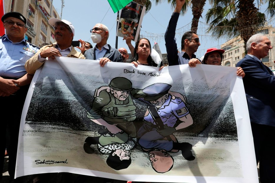 Palestinian demonstrators take part in a demonstration against police brutality and in support of US protesters over the death George Floyd, an unarmed black man who died after a white policeman knelt on his neck during an arrest in the US, in the centre of the occupied West Bank city of Ramallah on June 8, 2020 [ABBAS MOMANI/AFP via Getty Images]