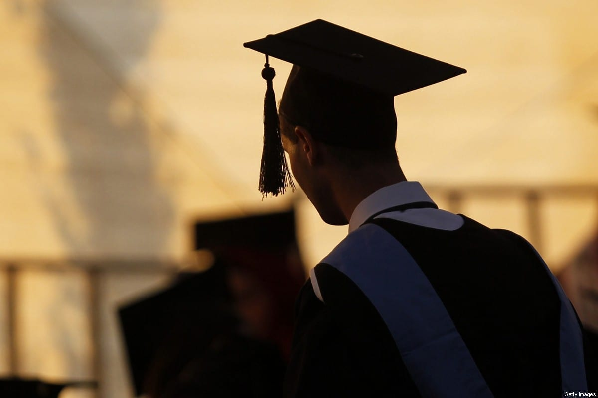 A Palestinian student attends his graduation ceremony on 26 June 2014 [ABBAS MOMANI/AFP/Getty Images]
