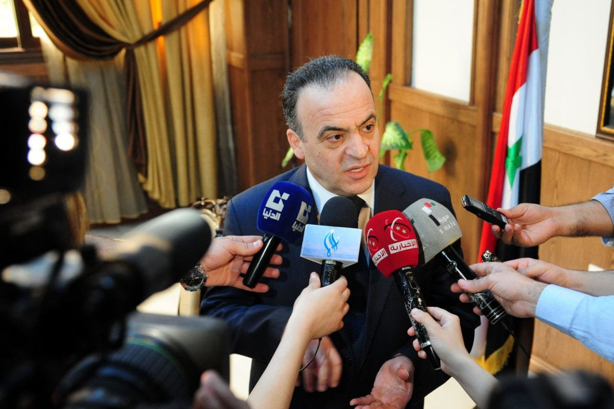 A picture taken on May 11, 2013 shows Syrian Electricity Minister Imad Khamis answering journalists' questions following a meeting in the Syrian capital Damascus. [STR/AFP via Getty Images]