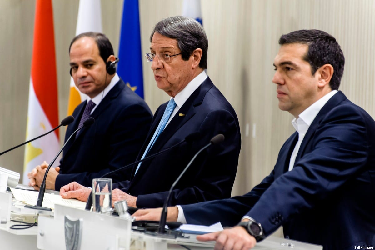 Cypriot President Nicos Anastasiades (C), Greek prime minister Alexis Tsipras and Egyptian President Abdel Fattah al-Sisi (L) attend a press conference at the presidential palace in Nicosia on November 21, 2017. [IAKOVOS HATZISTAVROU/AFP via Getty Images]
