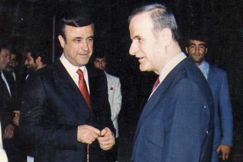Rifaat and Hafez al-Assad [Wikipedia]