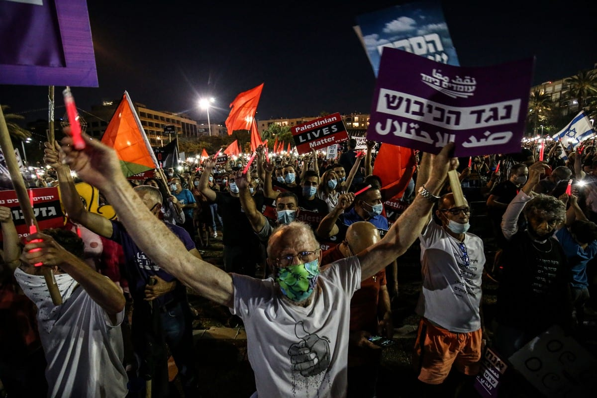 People gather to to protest against annexation in the West Bank on 6 June 2020, in Tel Aviv [Mostafa Alkharouf/Anadolu Agency]