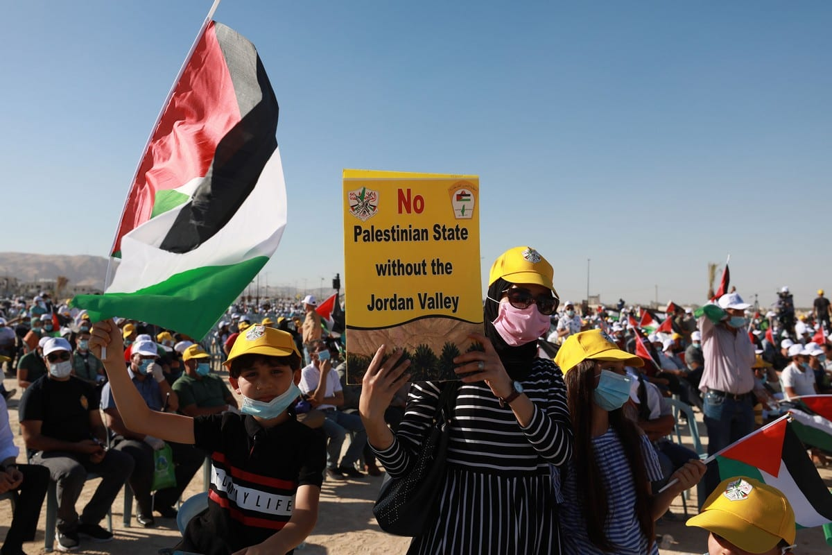 Palestinians gather to stage a protest against Jewish settlements and Israel's annexation plan of the West Bank on 22 June 2020 [Issam Rimawi/Anadolu Agency]