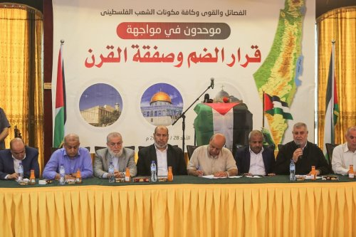 Palestinian Islamic Jihad Executive Khaled al-Batsh (2nd R), Hamas official Khalil al-Hayya (4th L), Al Fatah movement leader Imad al-Agha (4th R) and other group's representatives attend a meeting organized to determine a joint national plan against Israel's annexation plan in Gaza City, Gaza on 28 June 2020. [Mustafa Hassona - Anadolu Agency]