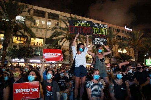 Hundreds of Israelis gather at the Rabin Square to protest against the government's coronavirus (COVID-19) policies in Tel Aviv, Israel on July 11, 2020. [Danile Bar On - Anadolu Agency]