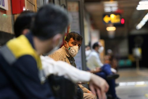 Iranians seen wearing masks at a subway during the novel coronavirus (COVID-19) pandemic precautions in Tehran, Iran June 15, 2020 [Fatemeh Bahrami / Anadolu Agency]