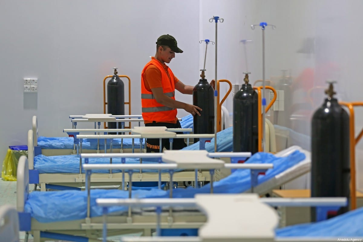 A health official prepares medical equipments for patients in Baghdad, Iraq on July 18, 2020 [Murtadha Al-Sudani/Anadolu Agency]
